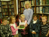 Patricia Gott reading to children at West Paris Library